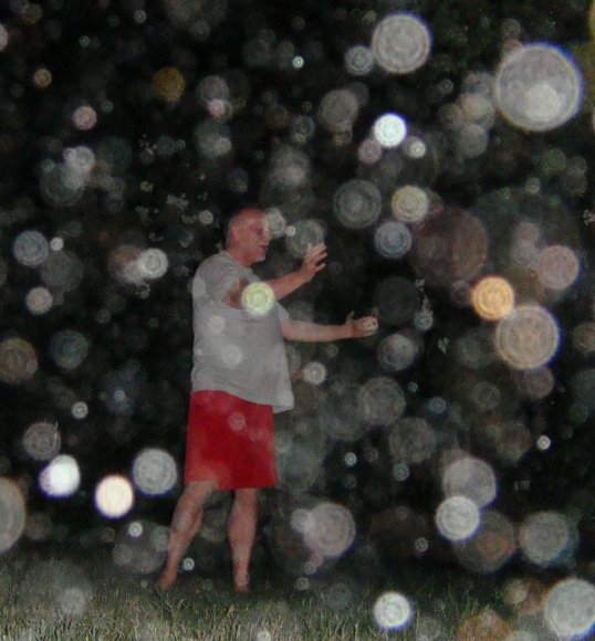Lance White with hundreds of light orbs