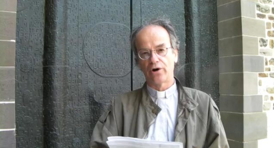 "Covenanter co-founder Rev. Kevin Annett reading the Maastricht Proclamation at the oldest ""Roman Catholic"" church outside Italy in Maastricht, Holland on April 20, 2014"