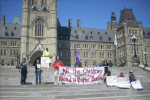 Kevin Annett (left) and Mohawk friends on Parliament Hill Ottawa, 2006