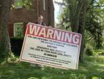 "U.S. SENATOR MICHAEL D. BROWN ERECTS ""WARNING"" SIGN ON HIS FRONT LAWN"