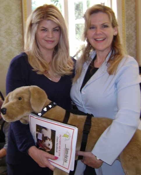 Denise teaching Kirstie Alley the doggie Heimlich