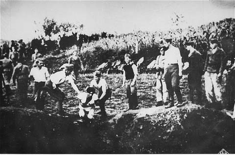 Execution of a Serb by Catholic Ustashe guards, Jasenovac death camp, Croatia